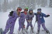 Adult onesies skiing